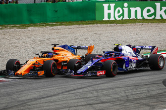 Fernando Alonso, McLaren MCL33, and Pierre Gasly, Toro Rosso STR13, go wheel-to-wheel