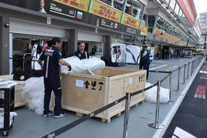 Racing Point Force India crew members and a crate
