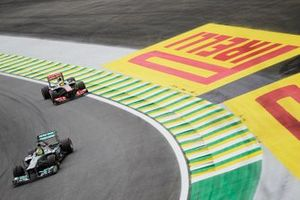Nico Rosberg, Mercedes W04 leads Sergio Perez, McLaren MP4-28