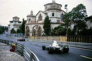 Denny Hulme, McLaren M23 Ford chases Jacky Ickx, Ferrari 312B3