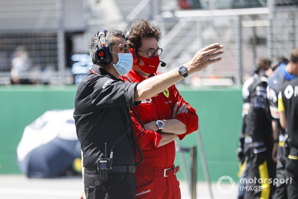 Guenther Steiner, Team Principal, Haas F1, and Mattia Binotto, Team Principal Ferrari, on the grid