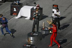 Race winner Valtteri Bottas, Mercedes-AMG Petronas F1 celebrates on the podium with the champagne with Charles Leclerc, Ferrari and Lando Norris, McLaren