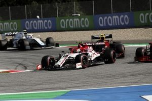Antonio Giovinazzi, Alfa Romeo Racing C39, leads Alex Albon, Red Bull Racing RB16, and Nicholas Latifi, Williams FW43