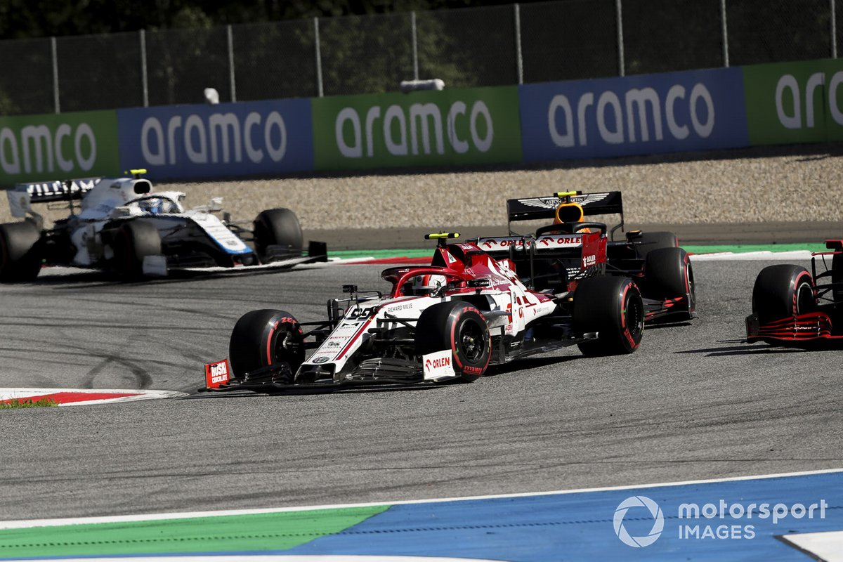 Antonio Giovinazzi, Alfa Romeo Racing C39, leads Alex Albon, Red Bull Racing RB16, and Nicholas Latifi, Williams FW43