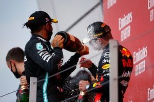 Lewis Hamilton, Mercedes F1 W11 sprays champagne on the podium with Race winner Max Verstappen, Red Bull Racing
