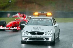 The safety car leads Rubens Barrichello, Ferrari F2002