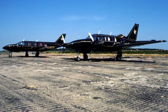 A pair of JPS liveried Piper Navajo Chieftains owned by Colin Chapman, Lotus Team Owner sit on the runway at Silverstone