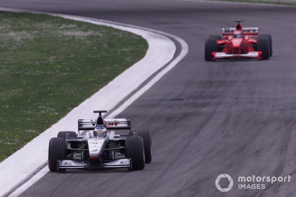 Mika Hakkinen, McLaren, leads Michael Schumacher, Ferrari