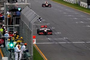 Jenson Button, McLaren MP4-25 Mercedes takes the chequered flag