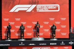 Lewis Hamilton, Mercedes-AMG Petronas F1, 2nd position, Max Verstappen, Red Bull Racing, 1st position, and Valtteri Bottas, Mercedes-AMG Petronas F1, 3rd position, on the podium