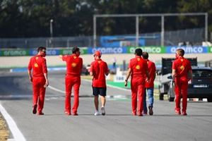 Sebastian Vettel, Ferrari, and Marc Gene walk the circuit