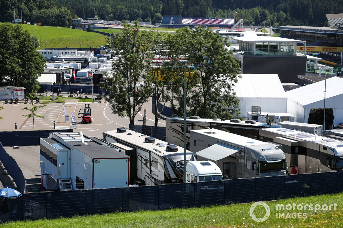 A scenic view of the paddock, including motorhomes and transporters