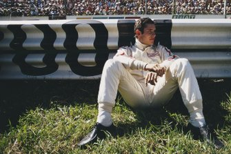 Jacky Ickx waits by the side of the track before the start