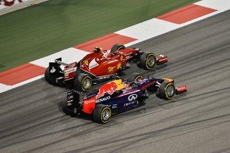Sebastian Vettel, Red Bull Racing RB10 and Kimi Raikkonen, Ferrari F14 T