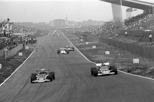 Jochen Rindt, Lotus 72C takes the lead from Jacky Ickx, Ferrari 312B at the end of lap 2