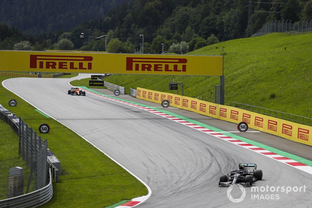 Valtteri Bottas, Mercedes F1 W11 EQ Performance, leads Lando Norris, McLaren MCL35