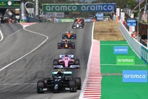 Valtteri Bottas, Mercedes F1 W11 , leads Sergio Perez, Racing Point RP20, and Alex Albon, Red Bull Racing RB16