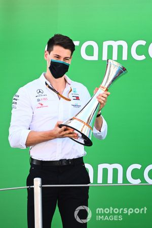 The Constructors trophy is collected by the Mercedes delegate