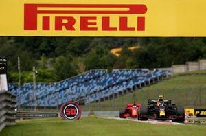 Alex Albon, Red Bull Racing RB16 and Sebastian Vettel, Ferrari SF1000