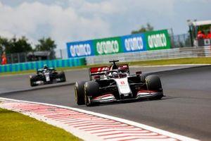 Romain Grosjean, Haas VF-20, leads Valtteri Bottas, Mercedes F1 W11