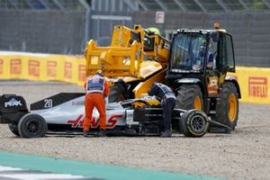A JCB recovering the car of Kevin Magnussen, Haas VF-20