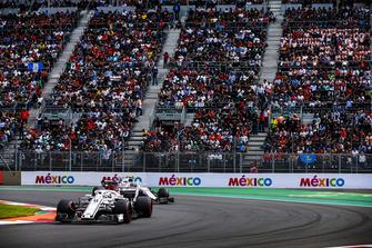 Marcus Ericsson, Sauber C37, leads Sergey Sirotkin, Williams FW41