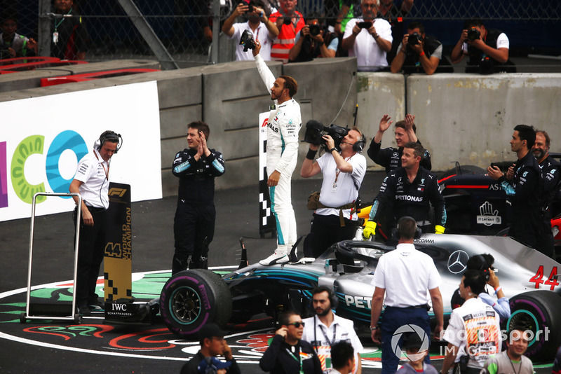 Lewis Hamilton, Mercedes AMG F1 W09 EQ Power+, celebrates in Parc Ferme after winning his fifth World Championship