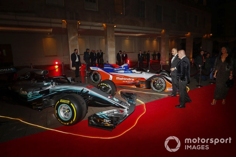 A Mercedes F1 car and Mahindra Formula E car on the red carpet