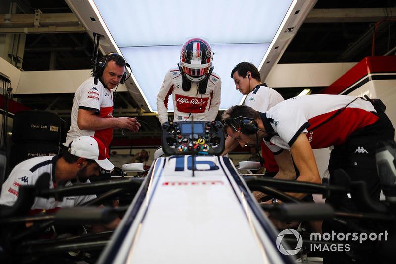 Charles Leclerc, Sauber, enters his cockpit.