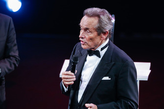 Jacky Ickx accepts a Gregor Grant Award on stage