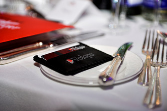 Volopa logo on a table setting