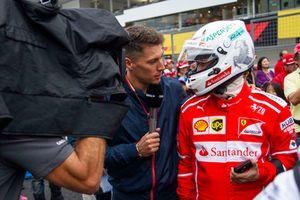 Fan of Sebastian Vettel, Ferrari talks with the media