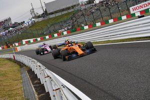 Lando Norris, McLaren MCL33 and Sergio Perez, Racing Point Force India VJM11