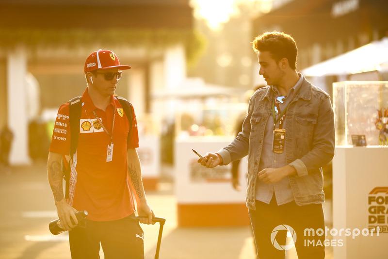 Kimi Raikkonen, Ferrari, signs a an autograph