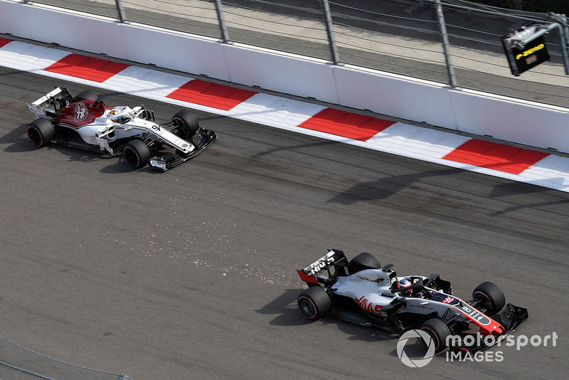 Romain Grosjean, Haas F1 Team VF-18 sparks and Marcus Ericsson, Sauber C37