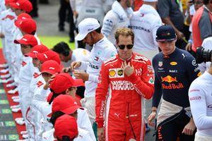 Sebastian Vettel, Ferrari and Max Verstappen, Red Bull Racing on the grid