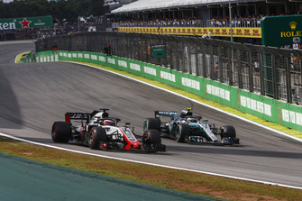 Valtteri Bottas, Mercedes AMG F1 W09 EQ Power+, passes Romain Grosjean, Haas F1 Team VF-18