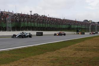 Valtteri Bottas, Mercedes AMG F1 W09 EQ Power+ leads Max Verstappen, Red Bull Racing RB14 and Kimi Raikkonen, Ferrari SF71H