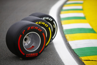 Three Pirelli tyres are displayed on the track