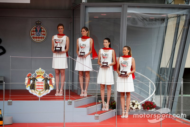 Trophies with grid girls on the podium