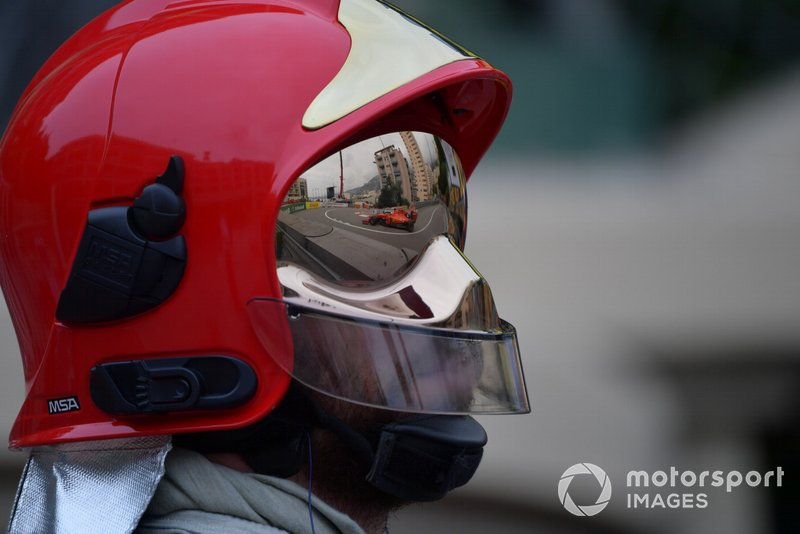 Sebastian Vettel, Ferrari SF90, reflected in a fire marshals visor