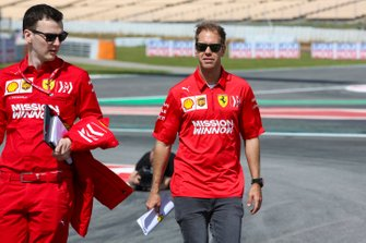 Sebastian Vettel, Ferrari, walks the track