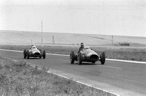 Mike Hawthorn, Ferrari 500, leads Luigi Villoresi, Ferrari 500