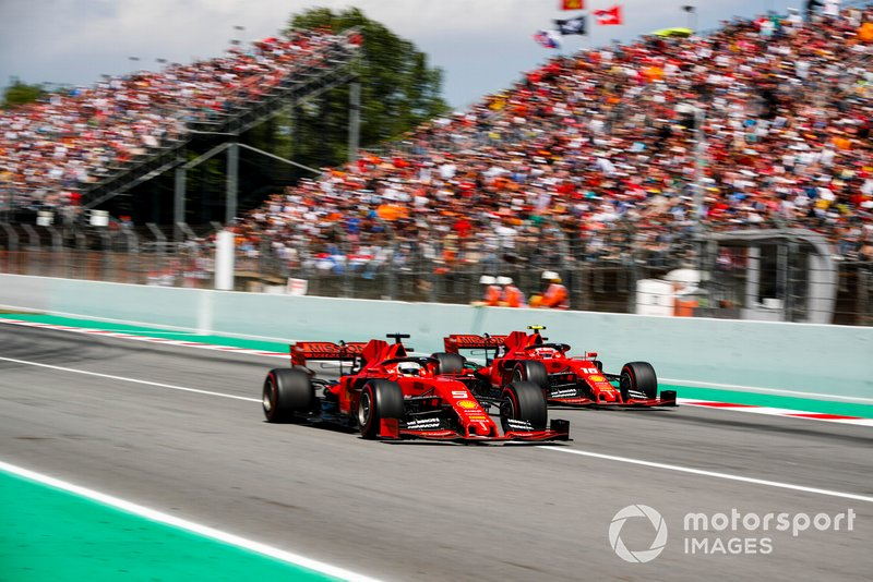 Sebastian Vettel, Ferrari SF90 and Charles Leclerc, Ferrari SF90 battle