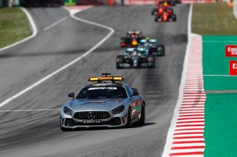 The Safety Car leads Lewis Hamilton, Mercedes AMG F1 W10, and Valtteri Bottas, Mercedes AMG W10