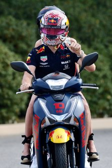 Pierre Gasly, Red Bull Racing, on a scooter with his girlfriend Caterina Masetti Zannini
