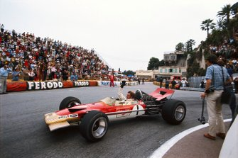 Graham Hill, Lotus 49B Ford, waves to the crowd at Station Hairpin