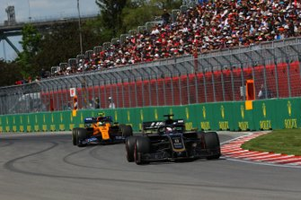 Romain Grosjean, Haas VF-19, leads Lando Norris, McLaren MCL34