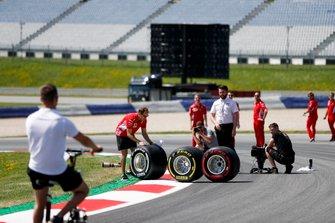 Sebastian Vettel, Ferrari helps stopping a Pirelli tyre rolling away during a photo shoot