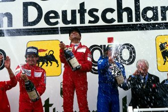 Podium: Alain Prost, McLaren 2nd, race winner Michele Alboreto, Ferrari and Jacques Laffite, Ligier 3rd